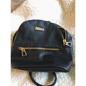 Black mini backpack with gold zipper!